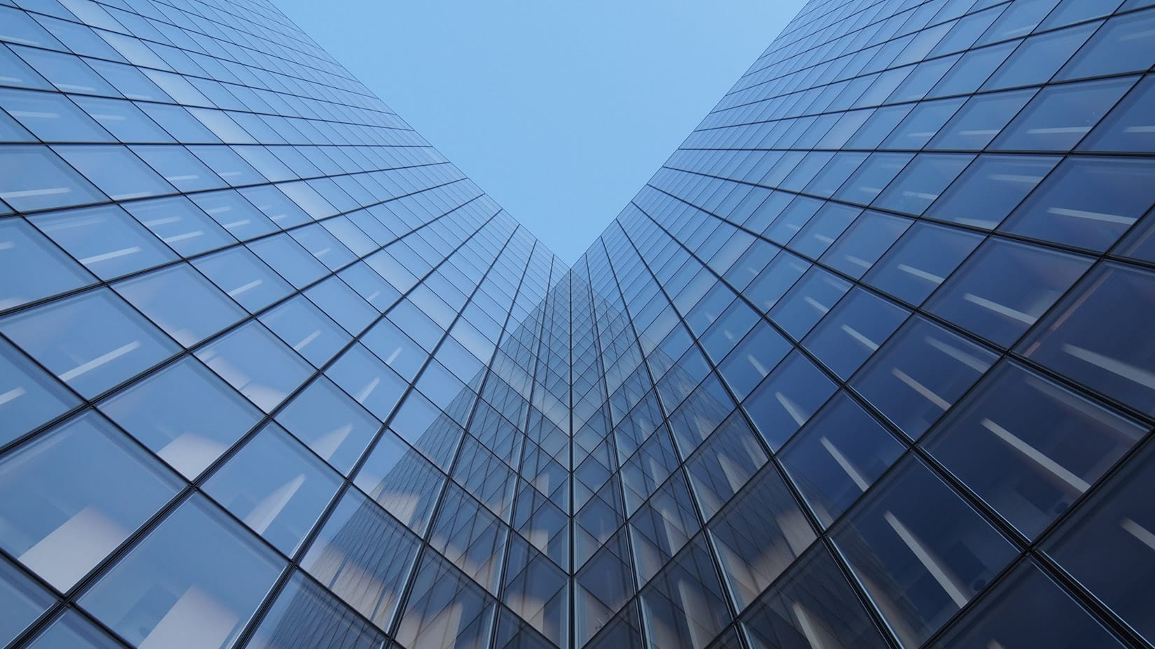 looking up at a glass building