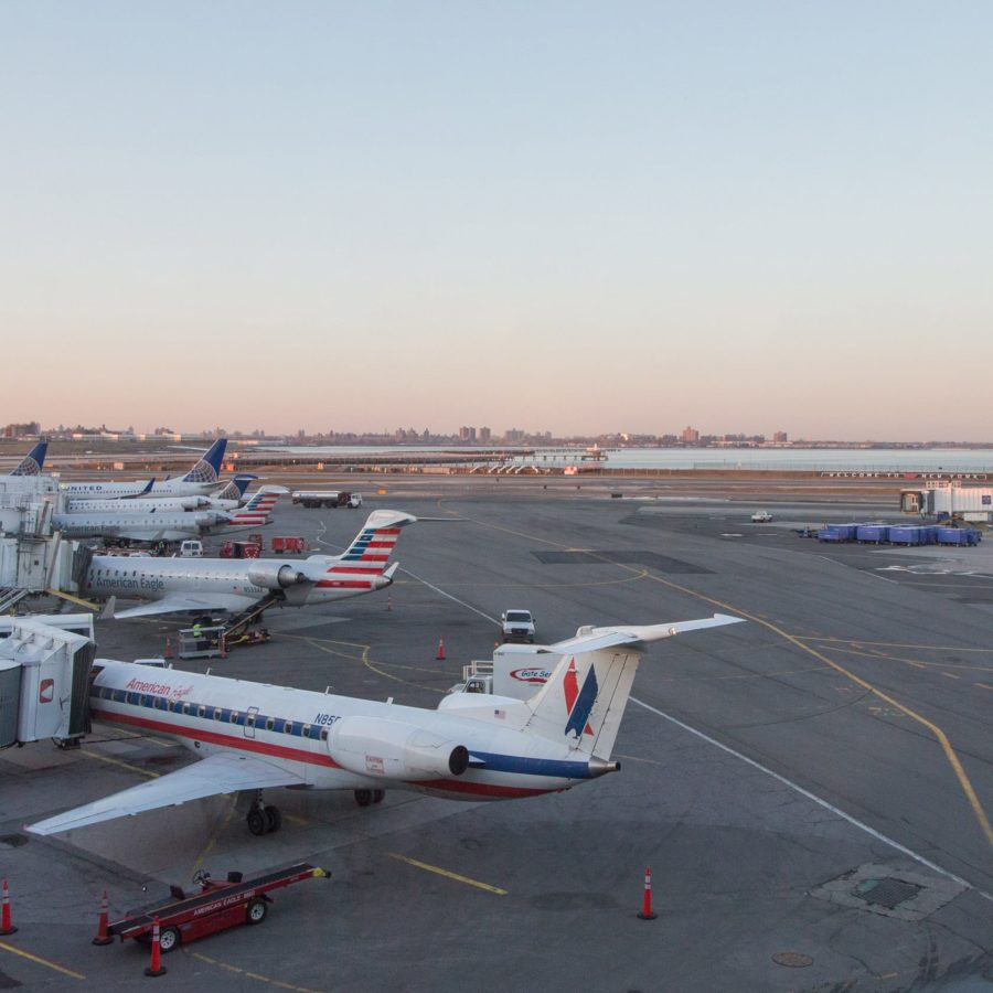 Plane on the LaGuardia airport runway at sunset